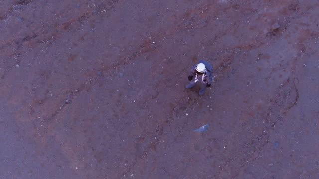 Aerial shot of astronaut walking on Mars