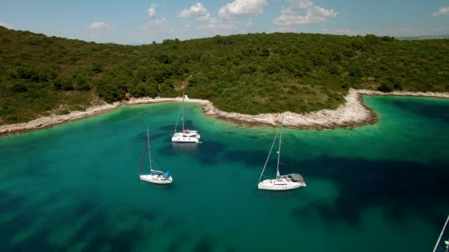 Aerial Shot of beautiful bay with yachts fly away