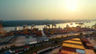 Aerial shot of Cargo Container port at sunset