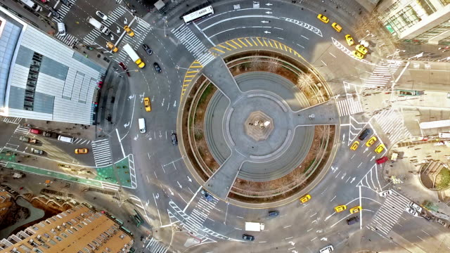 Aerial shot of Columbus Circle with cars driving around it, NYC