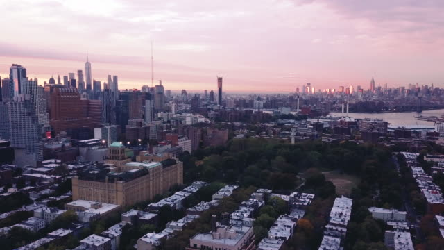 Aerial shot of New York City and Brooklyn at sunset.