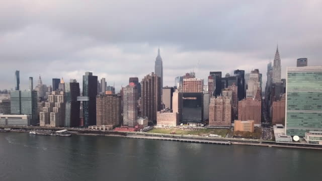 Aerial shot of New York City's Empire State Building on a cloudy day.