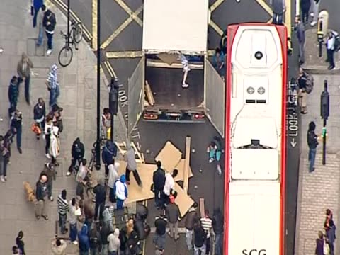 Aerial shot of rioters emptying a truck during riots in London August 2011