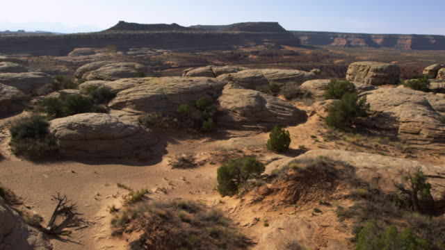 Aerial shot of rock formations at the Moab Desert with lens flare