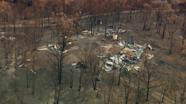 Aerial shot of the remains of house that was destroyed during a forest fire.