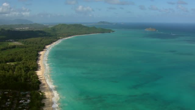 Aerial shot of the sandy shore and turquoise waters of Waimanalo Beach, Oahu.