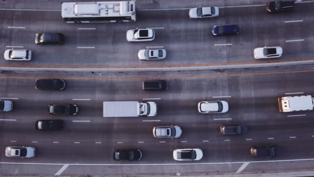 Aerial shot of traffic passing over an unrecognizable highway