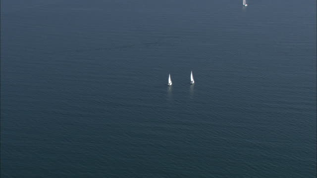 Aerial shot of two yachts sailing off the coast of Brittany.