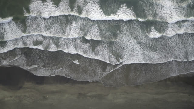 Aerial shot of waves on shoreline of beach