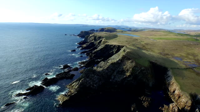 Aerial shot off the dramatic coast line of Shetland, Scotland,