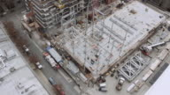 Aerial shot over a steel structure being constructed