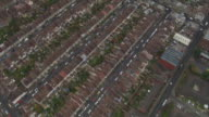 Aerial shot over rooftops of suburban houses