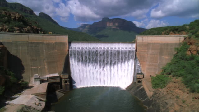 Aerial shot over the Blyde River Dam wall and across the waters