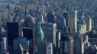 Aerial shot over the skyscrapers of Downtown Manhattan toward Tribeca in New York City.