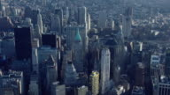 Aerial shot over the tall skyscrapers of New York City's Financial District in Lower Manhattan.