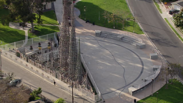 Aerial shot panning around the famous Watts Towers in South Los Angeles.