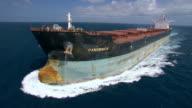 Aerial shot past a huge transport tanker.