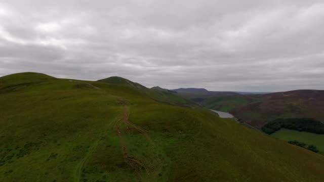 Aerial shot revealing the Pentland hills in Edinburgh, Scotland