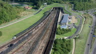 Aerial shots Eurotunnel Le Shuttle trains driving into the Channel Tunnel from Folkestone Terminal Eurotunnel trains driving into Channel Tunnel on...
