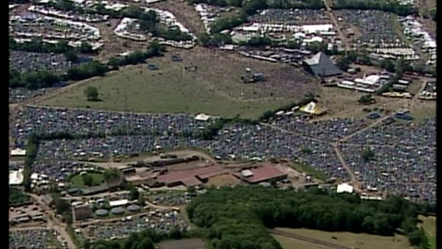 Aerial shots Glastonbury festival ground in misty weather packed with concert goers tents stages on June 25 2004 in Pilton Glastonbury England