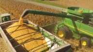 Aerial shots hover above a John Deere Co combine harvester as it collects corn stalks on a farm in Tskilwa Illinois US on September 30th 2015 Shots...