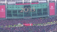 Aerial shots huge crowd of people surround the Manchester United players on top of their Premier League victory parade bus in front of Old Trafford...
