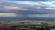 Aerial shots of a rainbow in a cloudy grey sky over a Loch and countryside on September 16 2010 on the West coast of Scotland