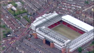 Aerial shots of Anfield Liverpool FC Football Club Stadium zoom into open top bus with players on board including Steven Gerrard Jamie Carragher Xabi...