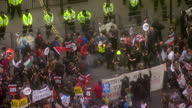 Aerial shots of antiausterity protesters demonstrating outside the gates of Downing Street on Whitehall during a march through central London with...