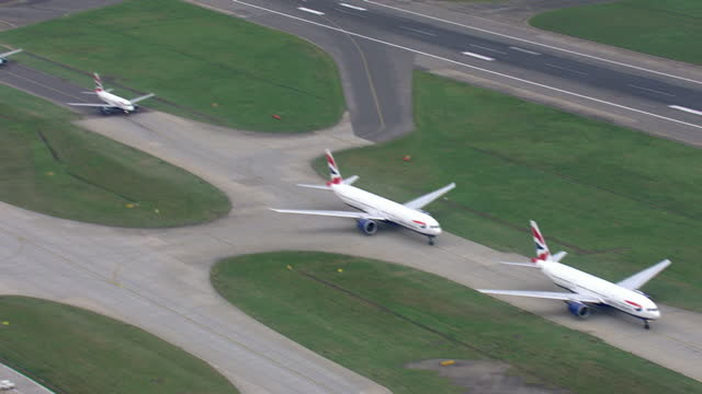 Aerial shots of British Airways planes waiting to go on runway and shots of British airways plane taking off at Heathrow Airport on December 10 2015...