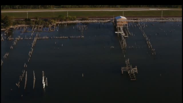 Aerial shots of damaged docks and debris on the outskirts of New Orleans Louisiana Shots of the marshes swamps bayou surrounding New Orleans...