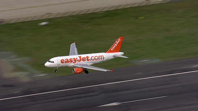 Aerial shots of EasyJet planes taking off and landing at Heathrow Airport and an air traffic control tower Air traffic control glitch causes major...