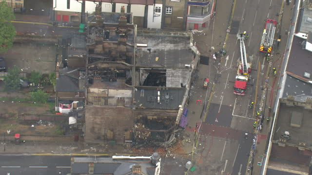 Aerial shots of fire fighters packing up equipment after putting out building fires started during the London riots in Tottenham on August 8 2011 in...