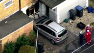 Aerial shots of house where fire took place with fire crews and emergency services gathered outside charred building Woman and four children killed...