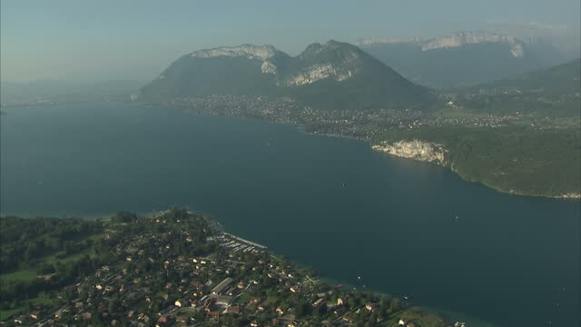 Aerial shots of Lake Annecy and the surrounding town and mountains on September 9 2012 in Annecy HauteSavoie France