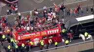 Aerial shots of Liverpool FC football team boarding double decker open top bus to take tour of Liverpool city with European Cup Trophy Champions...