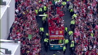 Aerial shots of Liverpool FC Football team open top bus parade celebrating European Cup Champions League victory as they past Anfield Stadium with...