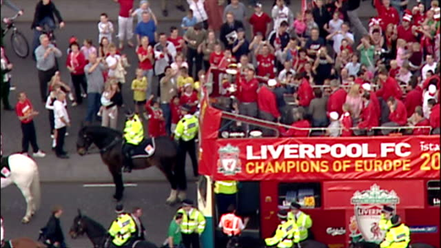 Aerial shots of Liverpool football club players including Steven Gerrard Jamie Carragher Jon Arne Riise Vladimir Smicer on open top bus with...