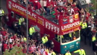 Aerial shots of Liverpool Football Team FC open top bus parade with Steven Gerrard Jamie Carragher Vladimir Smicer Xabi Alonso on bus celebrating as...