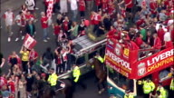 Aerial shots of Liverpool Football team on open top bus holding Champions League European Cup Trophy including shots of Steven Gerrard Jamie...