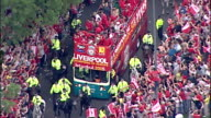 Aerial shots of Liverpool Football Team players including Steven Gerrard Jamie Carragher Valdimir Smicer Xabi Alonso on open top bus parade...
