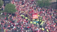 Aerial shots of Liverpool open top bus parade going through streets of Liverpool with players celebrating victory in European Champions League with...
