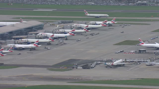 Aerial shots of London Heathrow Airport and British Airways planes parked next to hangars at Heathrow Airport on December 10 2015 in London England