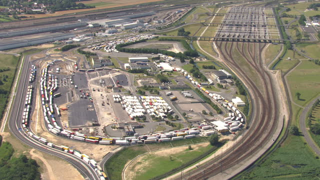 Aerial shots of lorries parked on roads leading to the Channel Tunnel lorries stacked and waiting on May 29 2015 in Coquelles France