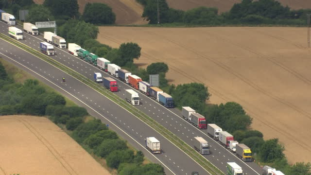 Aerial shots of lorries queueing and parked along the side of the M20 motorway during Operation Stack>> on July 29 2015 in Folkestone England