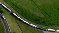 Aerial shots of lorries queueing towards the Channel Tunnel during disruption caused by striking ferry workers and groups of illegal migrants walking...