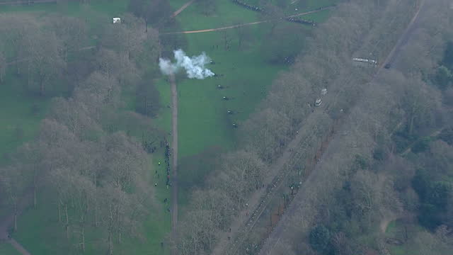 Aerial shots of members of the King's Troop Royal Horse Artillery firing a 41 gun salute in Green Park to mark the Queen's Sapphire Jubilee>> on...