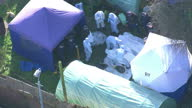 Aerial shots of police forensics workers and tents in the garden of missing actress Sian Blake's home in Erith where three bodies were found>> on...