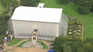 Aerial shots of scaffolding and sheeting covering Clandon House to protect the building that was gutted by fire in 2015 including shots of marquees...