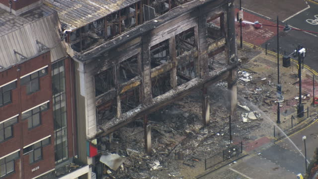 Aerial shots of smoke rising from a burnt out building previously Reeves furniture store in Croydon in the aftermath of the London riots on August 8...